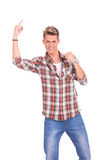 Casual young man pointing up Royalty Free Stock Image