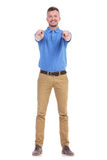 Casual young man points with both hands at you Royalty Free Stock Image