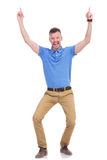 Casual young man points upward Royalty Free Stock Photos