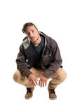 Casual young man. Posing isolated in white Stock Images