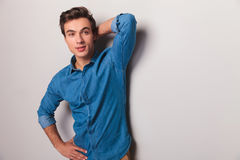 Casual young man posing and looks to side Stock Photos