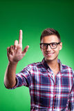 Casual young man pressing a button Royalty Free Stock Photography