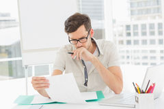 Casual young man reading document Royalty Free Stock Photography