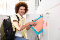 Casual young man shelving folders Royalty Free Stock Photo