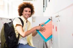 Casual young man shelving folders Royalty Free Stock Photo