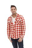 Casual young man in shirt and jeans Stock Photos
