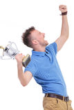 Casual young man shouts with trophy in hand Stock Image