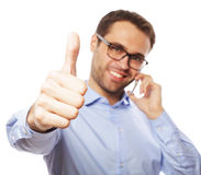 Casual young man showing thumbs up sign Stock Image