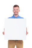Casual young man shows his blank board Royalty Free Stock Photo