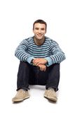 Casual young man sitting Stock Photography
