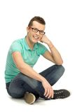 Casual young man sitting Stock Photos