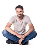 Casual young man sitting in lotus position Royalty Free Stock Photos