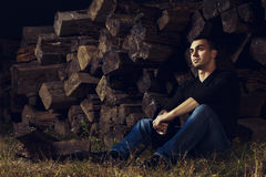 Casual young man sitting outdoor Stock Images