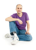 Casual young man sitting relaxed Royalty Free Stock Images