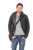 Casual young man smiling. Casual young man in jeans and cardigan smiling over white background Stock Images
