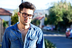 Casual young man smiling in the street Stock Photo
