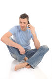 Casual young man speaking on phone Royalty Free Stock Photo