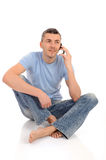 Casual young man speaking on phone Royalty Free Stock Photos