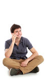 Casual young man speaking on the phone Stock Image