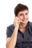Casual young man speaking on the phone Stock Photos