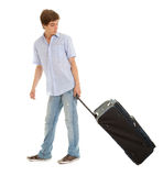 Casual young man with suitcase Stock Images