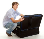 Casual young man with suitcase Royalty Free Stock Images