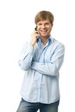 Casual young man talking on mobile Stock Photography