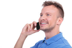 Casual young man talking on the phone Royalty Free Stock Photo