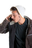 Casual young man. Talking at the phone isolated in white Royalty Free Stock Images