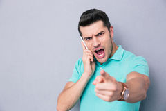 Casual young man talking on the phone Stock Image