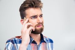 Casual young man talking on the phone Royalty Free Stock Photos