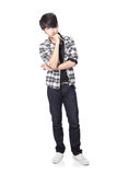 Casual young man thinking. In full body isolated on white background, asian model Stock Photography