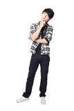 Casual young man thinking. In full body isolated on white background, asian model Stock Photo