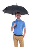 Casual young man with umbrella in hand Stock Photo