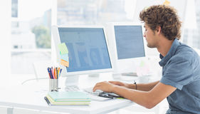 Casual young man using computer in office Royalty Free Stock Images