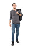 Casual young man walking forward carrying jacket over shoulder looking at camera Stock Photography