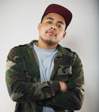 Casual young man wearing camouflage jacket posing Stock Photos