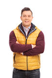 Casual young man wearing a yellow vest Stock Photo
