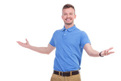 Casual young man welcomes you Stock Image
