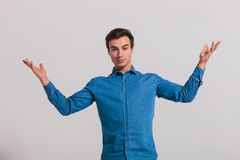 Casual young man welcoming Royalty Free Stock Photo