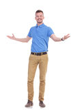 Casual young man is welcoming you Royalty Free Stock Images