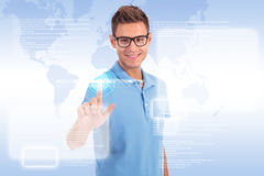 Casual young man working with touch screen Royalty Free Stock Image