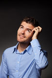Casual young pensive businessman Stock Photo