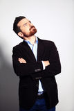 Casual young pensive businessman looking up at copyspace Stock Photo