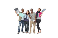 Casual young people with documents and digital table Stock Photo
