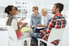 Casual young people in meeting Stock Image
