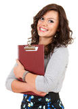 Casual young student woman with clipboard Royalty Free Stock Images