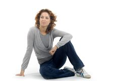 Casual young woman. An attractive young woman casually dressed in jeans and trainers Stock Images