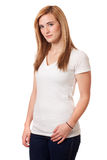 Casual Young Woman. Young woman in white t-shirt and jeans. Studio shot over white Stock Image