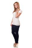 Casual Young Woman. Young woman in white t-shirt and jeans. Studio shot over white Stock Photography